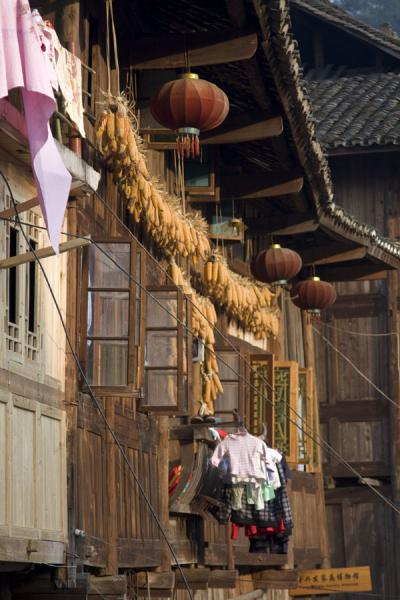 Chinese lanterns, corn, and laundry hanging outside a house in Xijiang | Xijiang | China