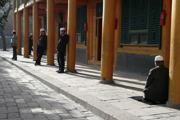 Muslim praying in the sun at the Great Mosque of Xining | Xining Mosque | China