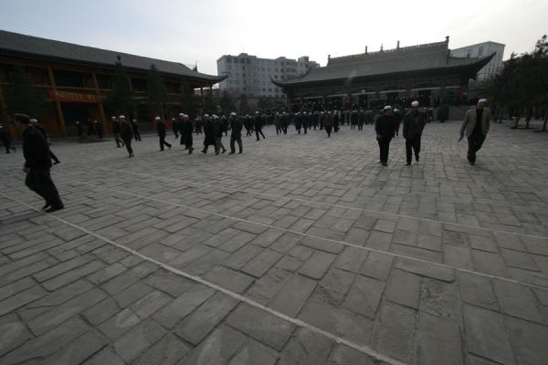Chinese Muslims on their way out after prayer | Xining Mosque | China