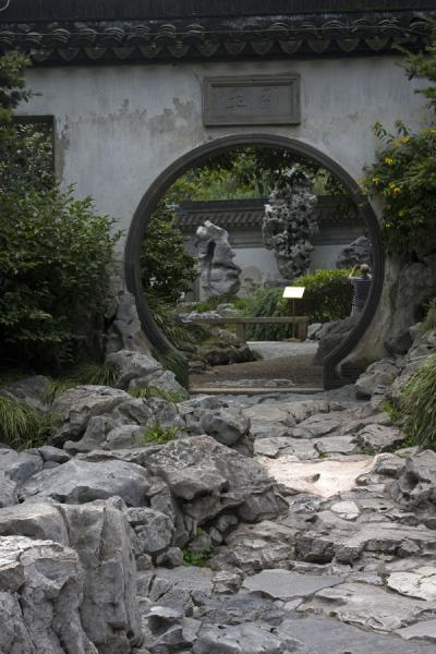 Picture of Rocky path leading to a circular opening in a wall in Yuyuan Garden