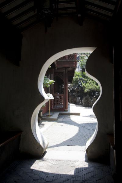 Oddly shaped passage in a wall in Yuyuan Garden | Yuyuan Garden | China