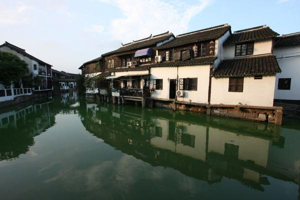 Typical white houses reflected in a canal in Zhujiajiao | Zhujiajiao Canal Town | China