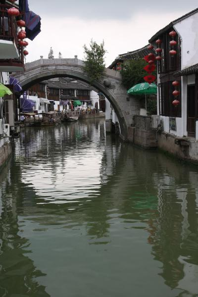 One of the circular bridges reflected in the main canal of Zhujiajiao | Zhujiajiao Canal Town | China