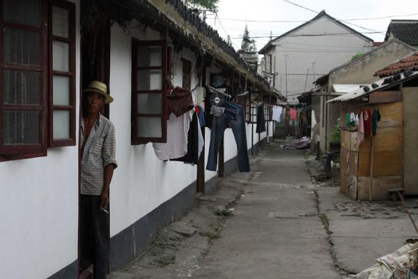 Picture of Alley with Chinese man and laundry