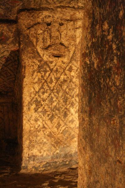 Face and pillar in a tomb of Tierradentro | Alto de Segovia tombs | Colombia
