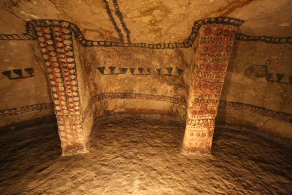 Brightly decorated columns in a tomb at Alto de Segovia | Alto de Segovia tombs | Colombia