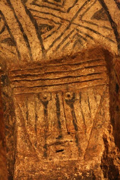 Relief of face and decorated wall in tomb at Tierradentro | Alto de Segovia tombs | Colombia