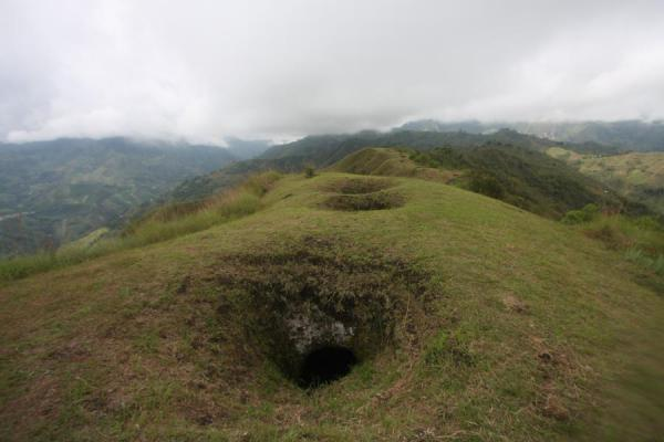 Ridge with subterranean tombs at El Aguacate | Alto Aguacate tombs | Colombia