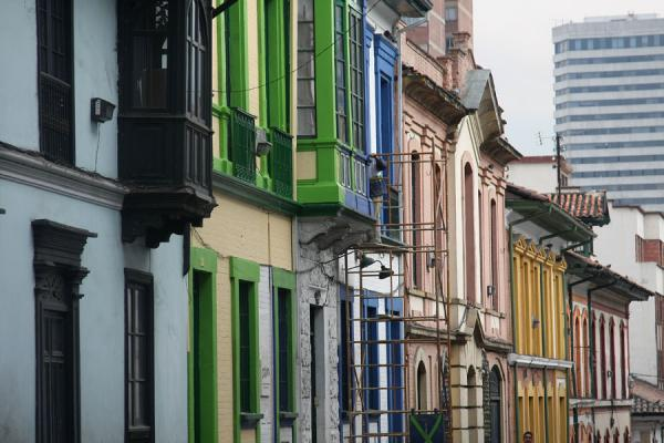Typical houses of La Candelaria with modern building in the background | La Candelaria | Colombia
