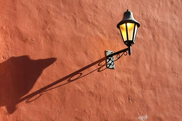 Picture of Lantern casting a long shadow in the early morning in Cartagena