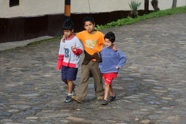 Three Colombian boys in a cobble stone street | Colombian people | Colombia