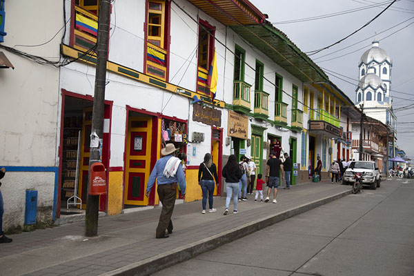 Main street of Filandia with colourful houses and the church | Filandia | Colombia