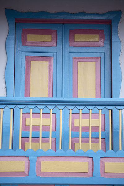 Closed doors and balcony painted in bright colours in Filandia | Filandia | Colombia