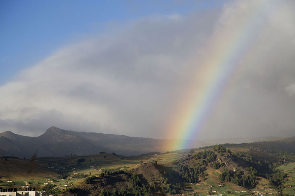 Picture of Rainbow over the landscape surrounding Lake TotaLago de Tota - Colombia