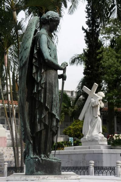 Picture of Statues decorate many family tombs at San Pedro cemetery