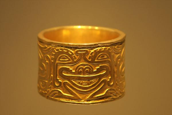 Picture of Museo del Oro (Colombia): Face in a golden bracelet in the Gold Museum