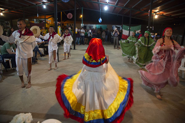 Locals performing for the foreign visitors in the evening in El Oso | Peace road to Marquetalia | Colombia