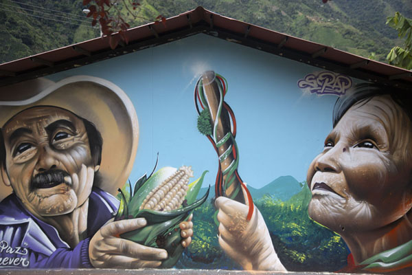 Farmers painted on a wall of a building in El Oso | Peace road to Marquetalia | Colombia