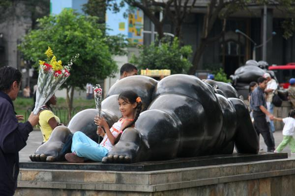 Colombian girl having a rest between the thighs of a voluptuous woman | Plaza Botero | Colombia