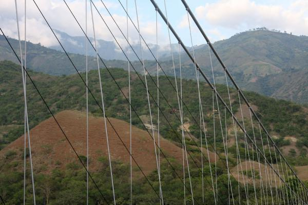 Picture of Puente de Occidente (Colombia): Green hills seen through the Puente de Occidente