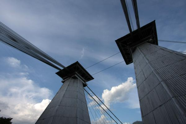 Two pyramidal towers on each side of the suspension bridge keep the bridge together | Puente de Occidente | Colombia