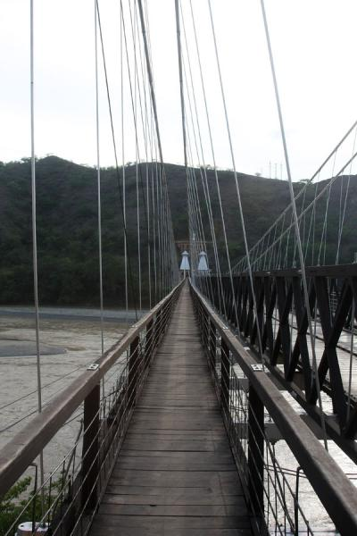 Walkway leading west with the pyramidal towers in the background | Puente de Occidente | Colombia