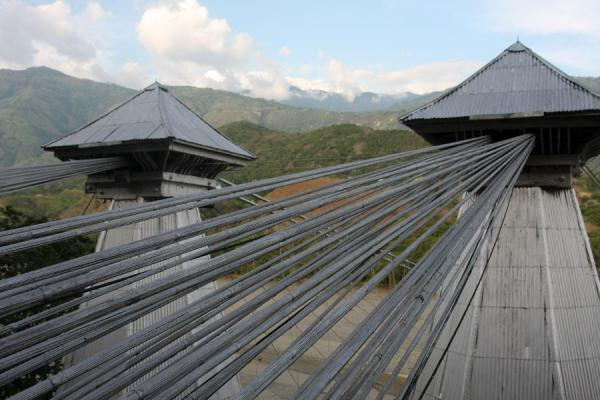 Close-up of the top of the pyramidal towers with metal cables | Puente de Occidente | Colombia