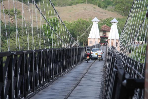 Car and motor cyclists crossing the bridge | Puente de Occidente | Colombia