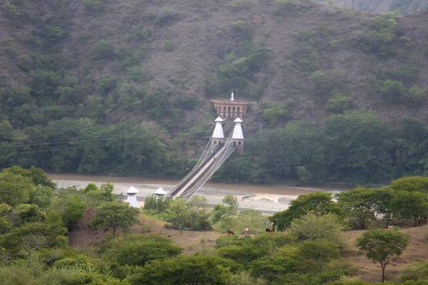 Picture of Puente de Occidente (Colombia): Suspension bridge crossing the Cauca river seen from a distance