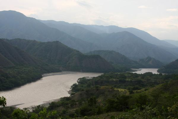 Picture of Puente de Occidente (Colombia): Rolling hills rising up from the Cauca river near the Puente de Occidente