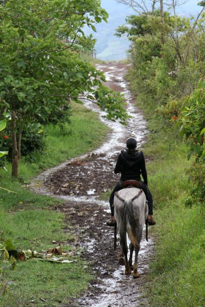 Getting on horse from one place to the next near San Agustín | San Agustín Archeological sites | Colombia