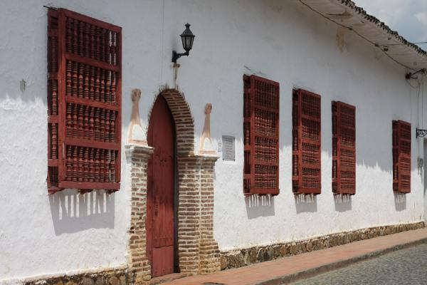 Colonial house with typical wooden window guards in a street of Santa Fé de Antioquia | Santa Fé de Antioquia | Colombia