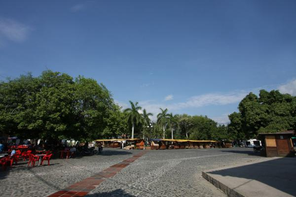 Picture of City square with market stals and trees are the heart of Santa Fé de Antioquia