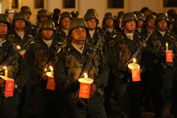 Military with guns and candles at the closure of another Semana Santa procession | Semana Santa Popayán | Colombia