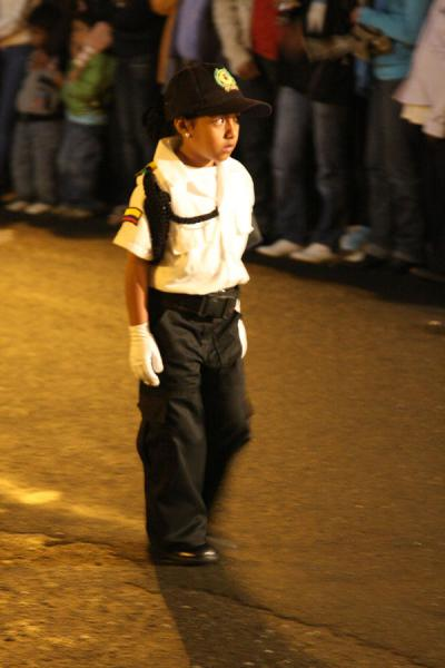 Foto van Colombian child walking ahead of the processionSemana Santa Popayán - Colombia