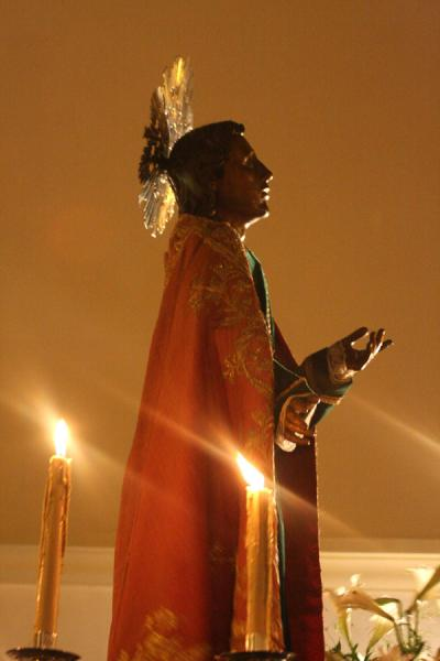 Picture of Real candles are used to lighten up the statues of holy figures