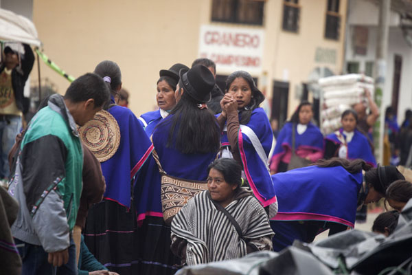 Picture of Guambiano women in their traditional dresses at the market of Silvia