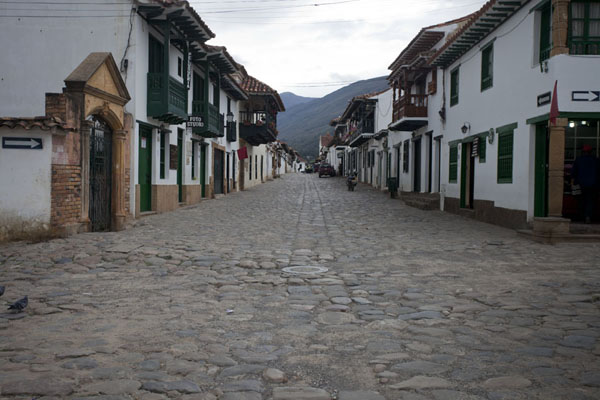 Picture of Typical street in Villa de Leyva: cobble stone streets and colonial houses in white and green