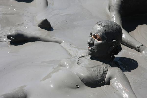 Woman floating on the thick mud of Volcano Totumo | Totumo Volcano | Colombia