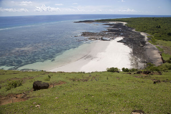 White beach seen from the slopes of the volcanic crater of Lac Salé | Lac Salé | Comoras