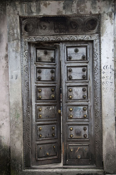 Wooden door richly decorated by carvings in the old town of Moroni | Moroni old town | Comoros