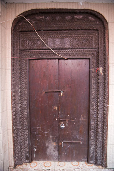 Decorations carved out of this wooden door in the medina | Mutsamudu medina | Comoros