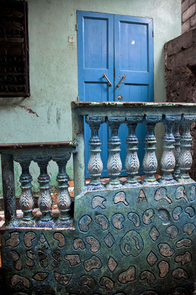 Picture of Mutsamudu medina (Comoros): Colourful balustrade and door in a house in the medina of Mutsamudu