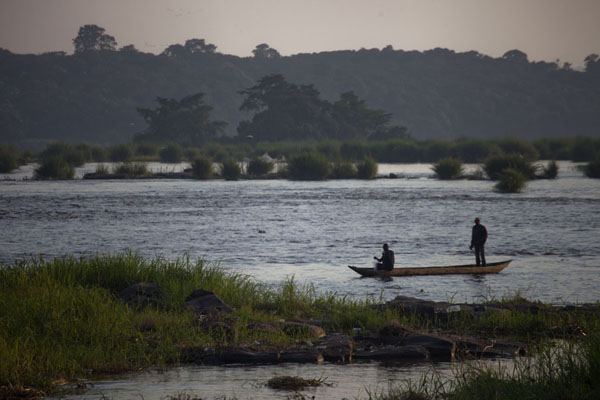 Picture of Brazzaville (Congo): Men steering a pirogue upstream at the rapids near Pont Djoué