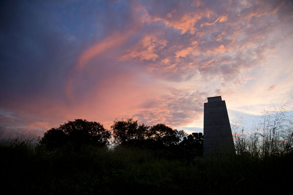 Foto di Sunset over the memorial pillar for Pierre Savorgnan de BrazzaBrazzaville - Repubblica del Congo