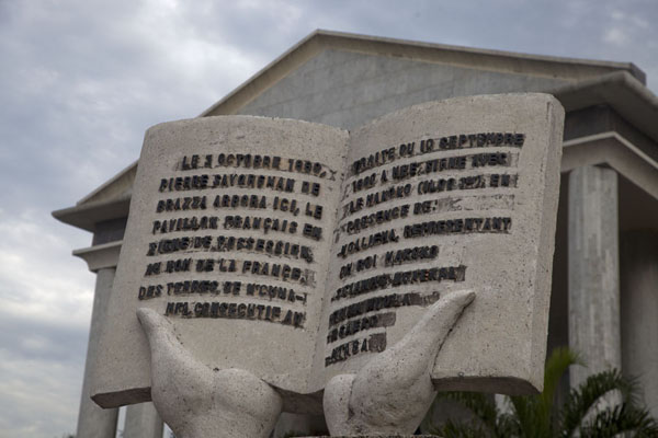 Picture of Brazzaville (Congo): Pages with text sculpted at the memorial for the founder of the city Brazzaville