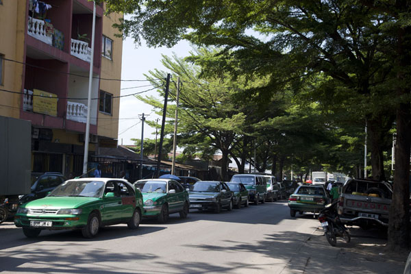 Tree-lined street with the ubiquitous green taxis | Brazzaville | Congo