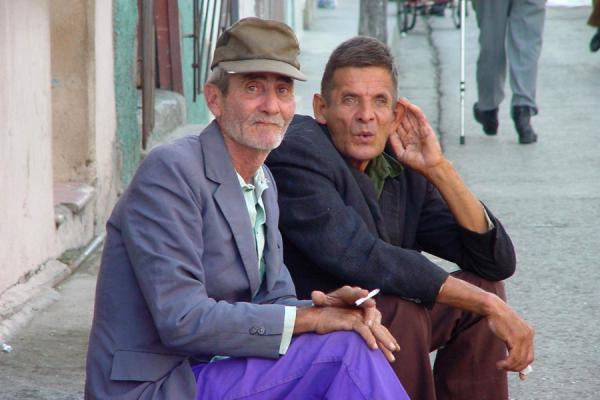 Sitting on the sidewalk | Cuban people | Cuba