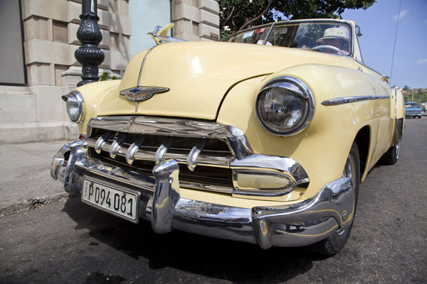 Picture of Yellow vintage Chevrolet parked in a street in HavanaHavana - Cuba
