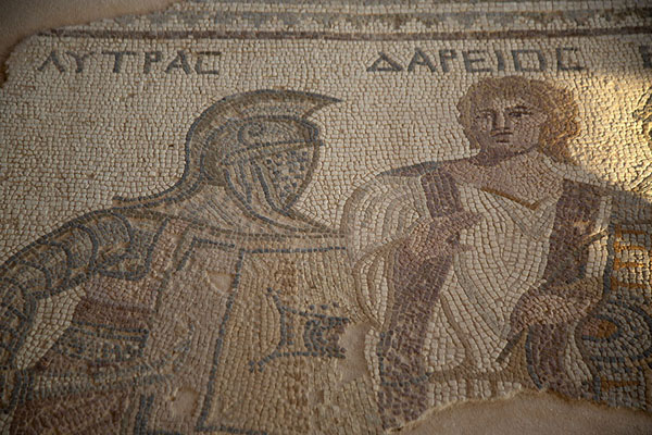 Foto van Detail of mosaic with two gladiators separated by a juryKourion - Cyprus